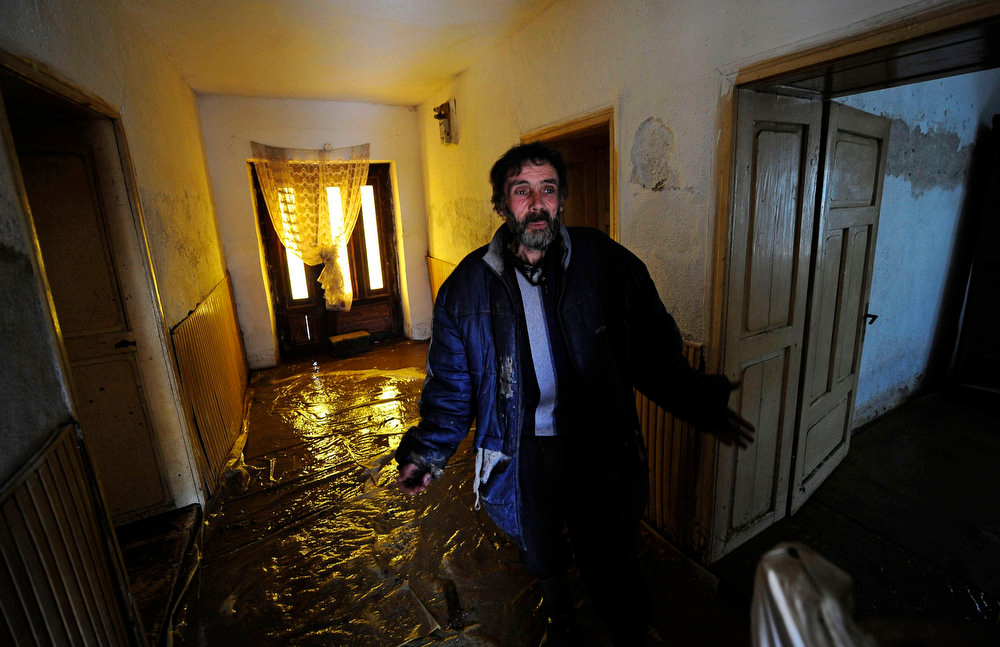Description of . A man gestures as he wades through floodwater in his house in Murtino, 180 km east of Skopje February 27, 2013. One man drowned and several hundred homes in Macedonia were flooded on Tuesday as two days of heavy rain drenched farmland and caused power outages in the Balkan country, authorities said. REUTERS/Ognen Teofilovski
