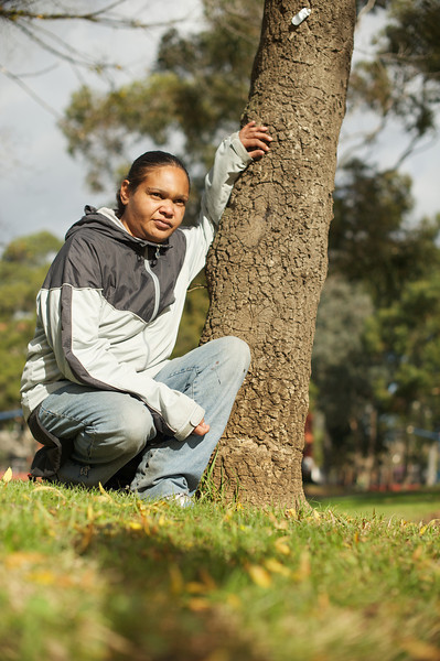 This model was photographed in an urban location.  The tree whe is touching has special meaning to her.