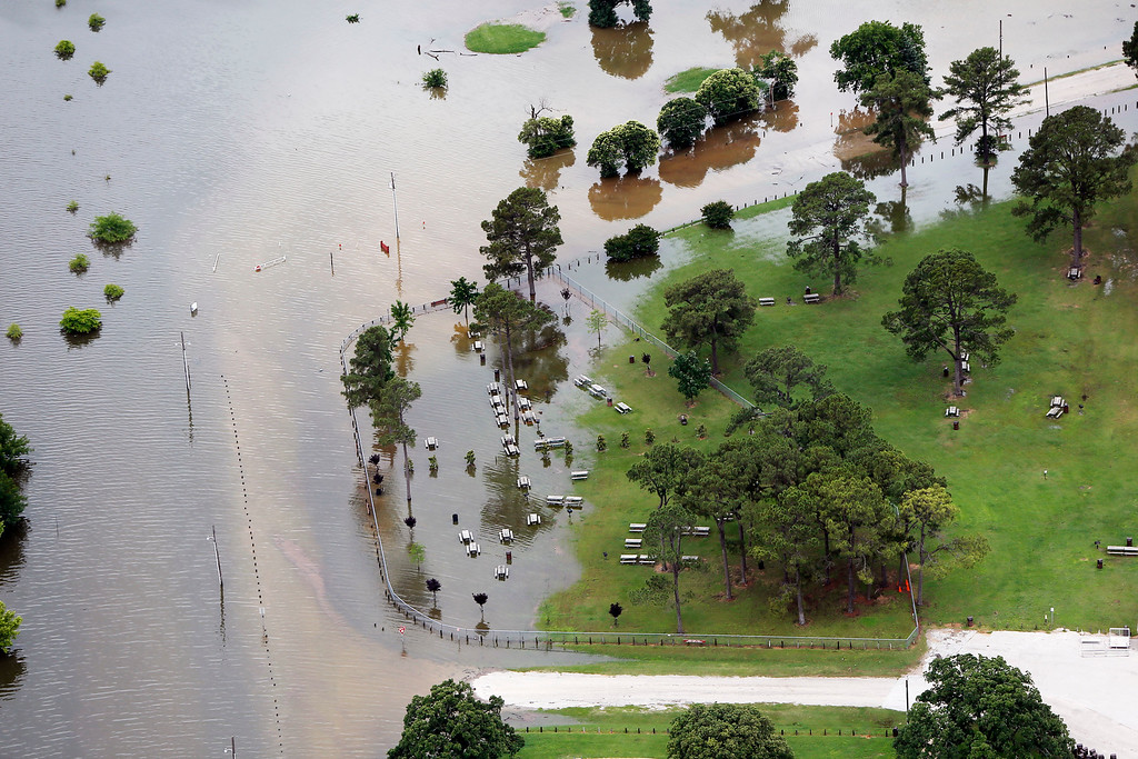 . Lake Lewisville encroaches into a park, Friday, May 29, 2015 in Lewisville, Texas. Floodwaters submerged Texas highways and threatened more homes Friday after another round of heavy rain added to the damage inflicted by storms. (AP Photo/Brandon Wade)