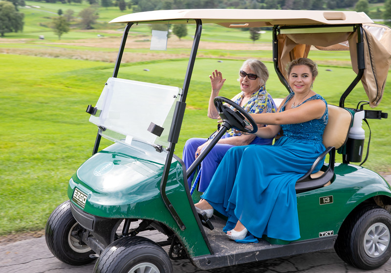 Briana and Grandmother Entrance on Golf Cart.jpg