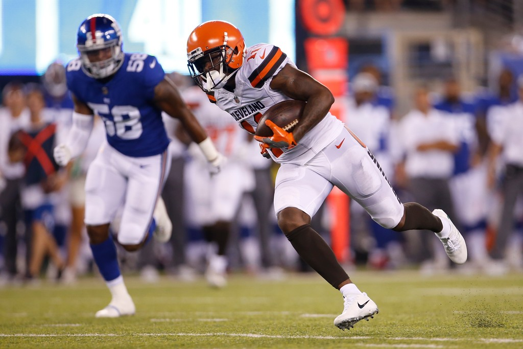 . Cleveland Browns\' Antonio Callaway (11) runs for a touchdown as New York Giants\' Tae Davis (58) chases him during the second half of a preseason NFL football game Thursday, Aug. 9, 2018, in East Rutherford, N.J. (AP Photo/Adam Hunger)