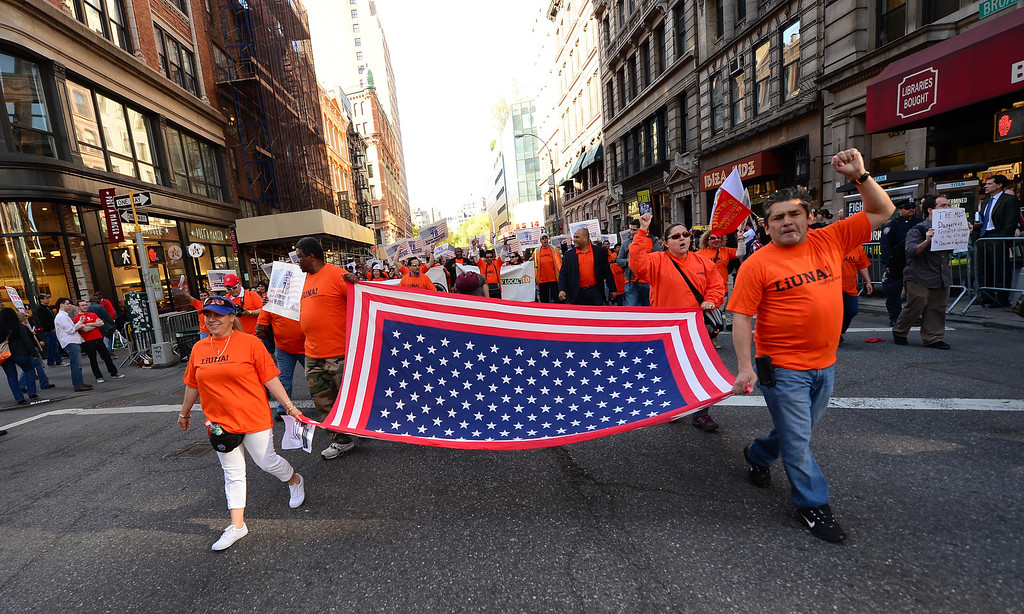 . Demonstrators take part in a May Day march, in New York, May 1, 2013. Union workers, immigrant rights activists and Occupy Wall Street supporters staged a rally and a march to celebrate May Day.   EMMANUEL DUNAND/AFP/Getty Images