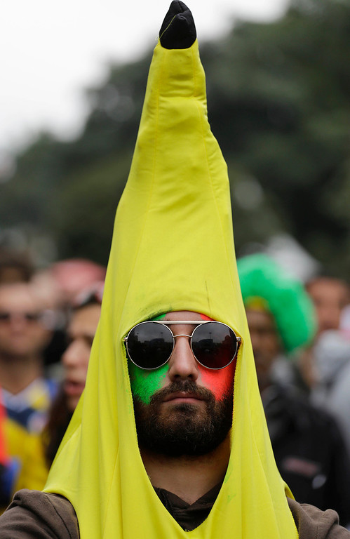 . An Italy soccer fan wearing a banana costume watches his team\'s World Cup game loss to Costa Rica inside the FIFA Fan Fest area in Sao Paulo, Brazil, Friday, June 20, 2014. (AP Photo/Nelson Antoine)