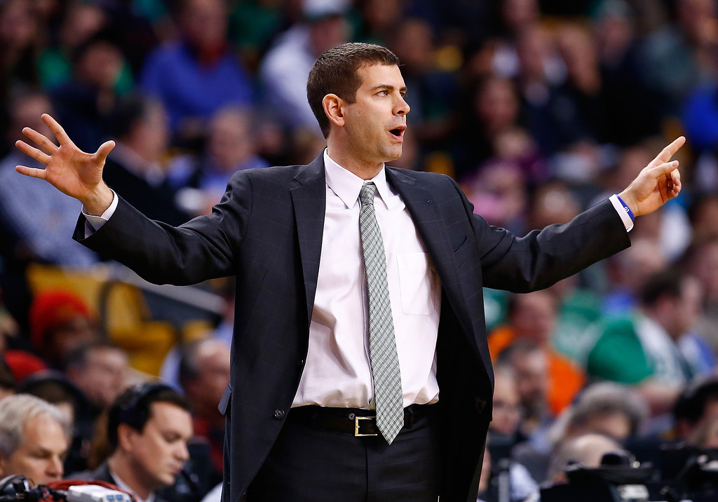 . BOSTON, MA - DECEMBER 06: Head coach Brad Stevens of the Boston Celtics communicates with his team in the first quarter against the Denver Nuggets during the game at TD Garden on December 6, 2013 in Boston, Massachusetts.  (Photo by Jared Wickerham/Getty Images)