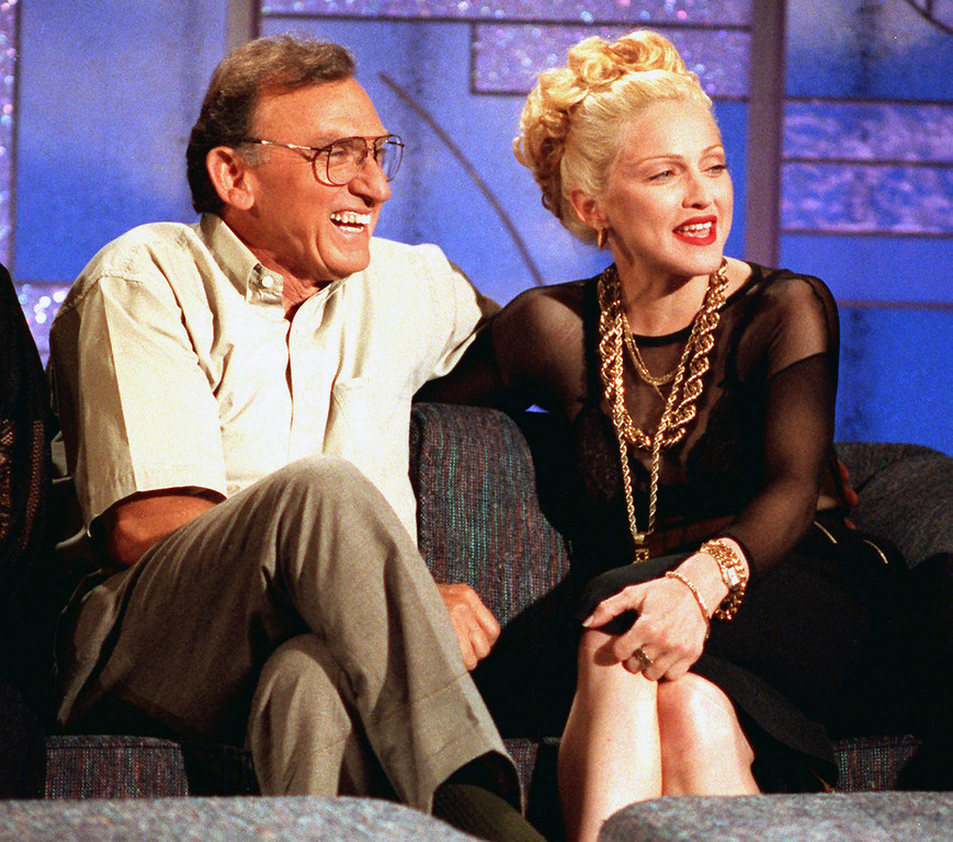 . Madonna and her father, Tony Ciccone, laugh as they talk with Arsenio Hall during taping of Hall\'s talk show in Los Angeles.   Hall arranged the meeting without Madonna\'s knowledge. (AP Photo, file)