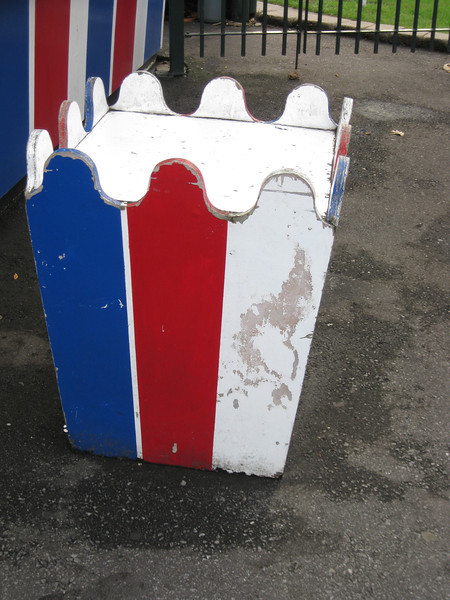 Themed trash can next to the Popcorn stand.