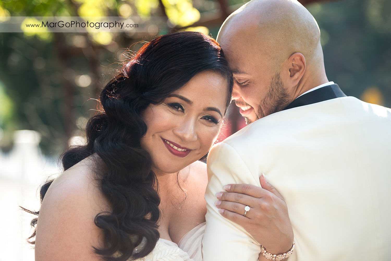 portrait of the bride resting her head on groom's arm at Sunol's Casa Bella