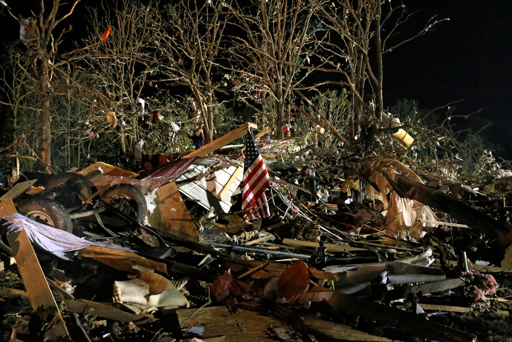 Description of . A flag flies in the debris of a mobile home after a tornado struck a mobile home park near Dale, Okla., Sunday, May 19, 2013. (AP Photo Sue Ogrocki)