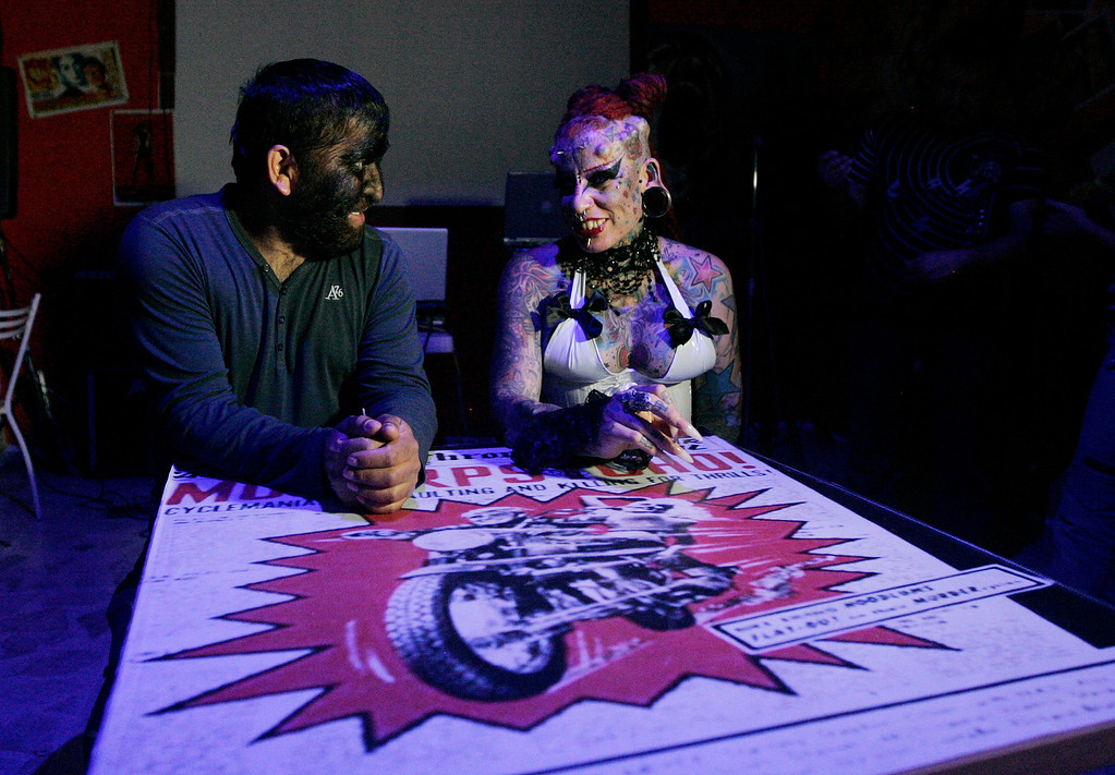 ". Jesus Fajardo Manuel Aceves (L) talks to Mary Jose Cristerna, known as the ""Vampire Woman\"", while making plans for a joint music project at a cultural center in Zapopan October 5, 2012. Fajardo, whom people call \""Chuy the Werewolf\"", suffers from a rare congenital condition called hypertrichosis, also known as the Werewolf Syndrome, a medical condition resulting in excessive growth of facial and body hair. Fajardo started working in a circus at age 13 but quit after acting as a werewolf for 20 years. He now works in a carpentry firm making furniture and occasionally holds conferences on his condition, teaching others to accept people who are different. Picture taken October 5, 2012.  REUTERS/Alejandro Acosta"
