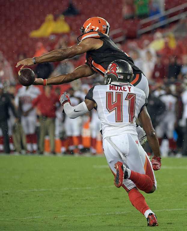 . Cleveland Browns wide receiver Jordan Leslie (11) makes a catch in front of Tampa Bay Buccaneers cornerback Jonathan Moxey (41) during the fourth quarter of an NFL preseason football game Saturday, Aug. 26, 2017, in Tampa, Fla. (AP Photo/Phelan Ebenhack)