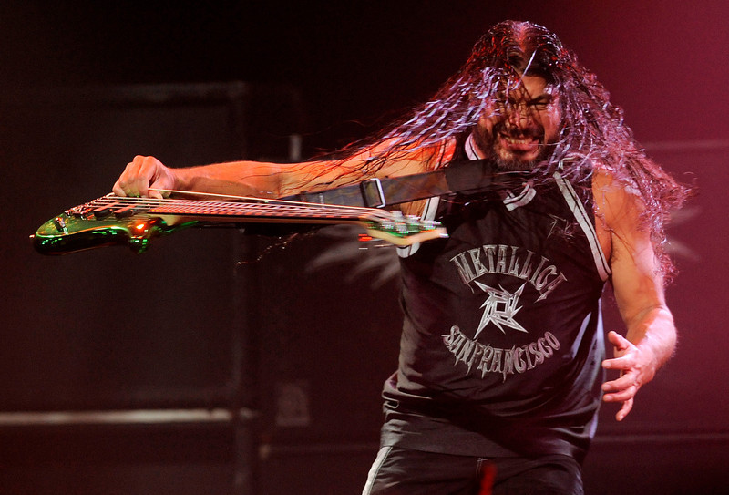 . Robert Trujillo of Metallica swings his bass around during the band\'s set at the 2013 Revolver Golden Gods Award Show at Club Nokia on Thursday, May 2, 2013 in Los Angeles. (Photo by Chris Pizzello/Invision/AP)
