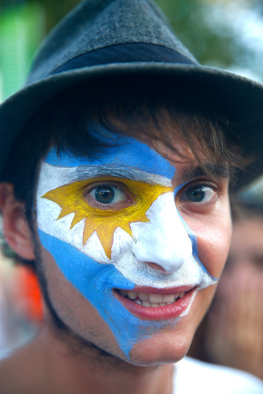 . Argentina fans pose with painted faces during the 2014 FIFA World Cup Brazil Group F match between Argentina and Bosnia-Herzegovina at Maracana on June 15, 2014 in Rio de Janeiro, Brazil.  (Photo by Clive Rose/Getty Images)