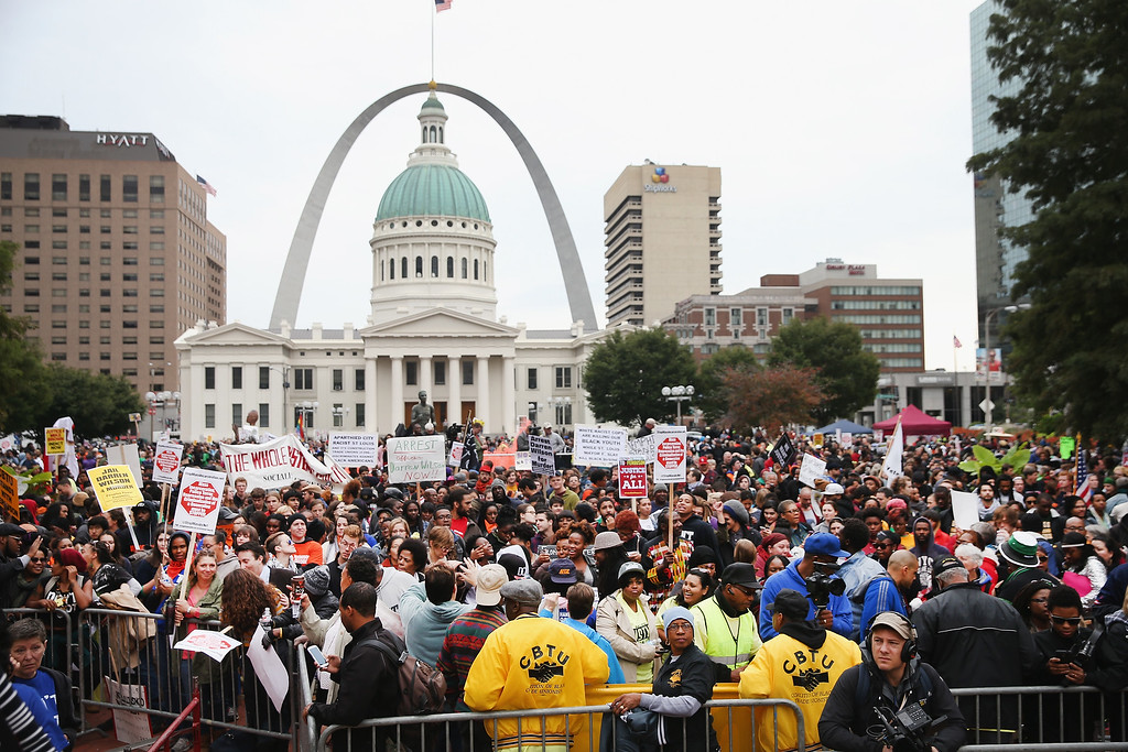 . ST LOUIS, MO - OCTOBER 11:  Inspired by the August 9 death of Michael Brown in Ferguson, Missouri, demonstrators march through downtown to protest racial injustice on October 11, 2014 in St. Louis, Missouri. Brown, an 18-year-old black man, was not armed when he was shot and killed by Darren Wilson, a white Ferguson police officer.  (Photo by Scott Olson/Getty Images)