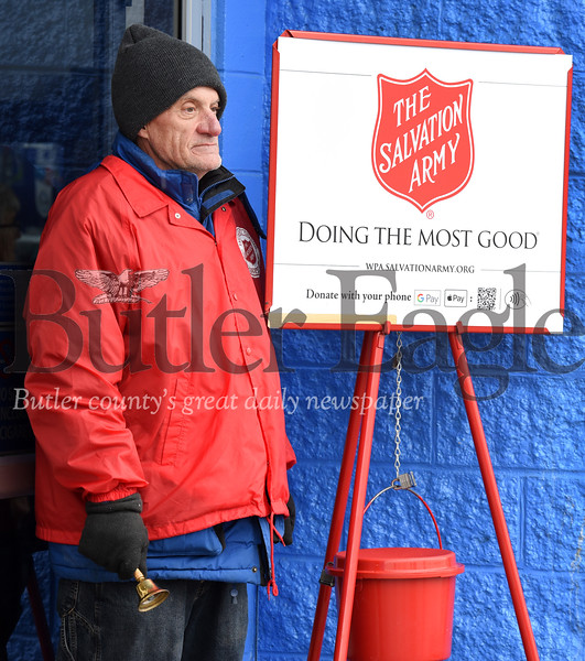 "Harold Aughton/Butler Eagle: Frank Miller of Butler has been volunteering collecting donations for the Salvation Army for the past five years. According to Miller, he enjoys volunteering for a worthy cause. ""I get to meet thousands of people each day."""