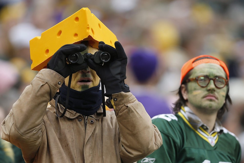 . Fans of the Green Bay Packers watch the game against the Minnesota Vikings at Lambeau Field on December 2, 2012 in Green Bay, Wisconsin.  The Packers defeated the Vikings 23-14.  (Photo by Wesley Hitt/Getty Images)