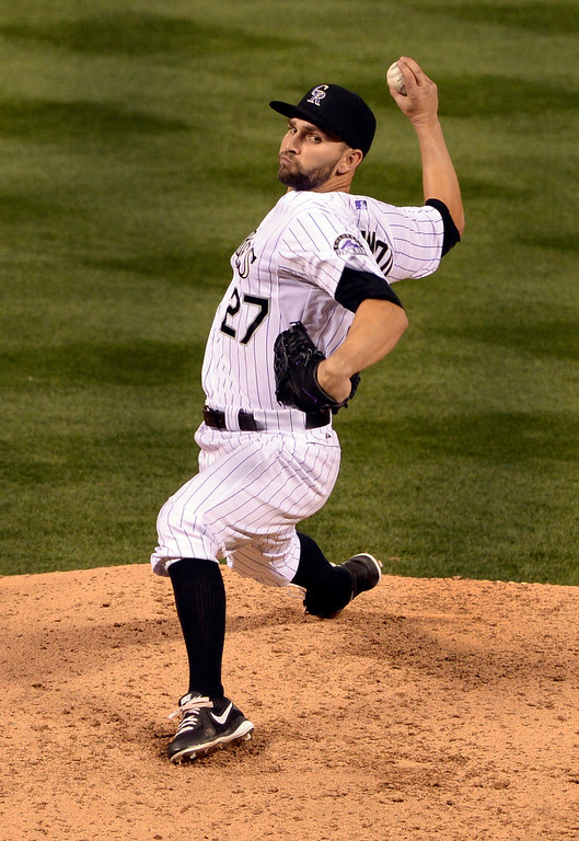 . DENVER, CO - APRIL 18: Colorado pitcher Tyler Chatwood delivered to the plate in the seventh inning. The Colorado Rockies defeated the Philadelphia Phillies 12-1 Friday night, April 18, 2014 at Coors Field.  (Photo by Karl Gehring/The Denver Post)