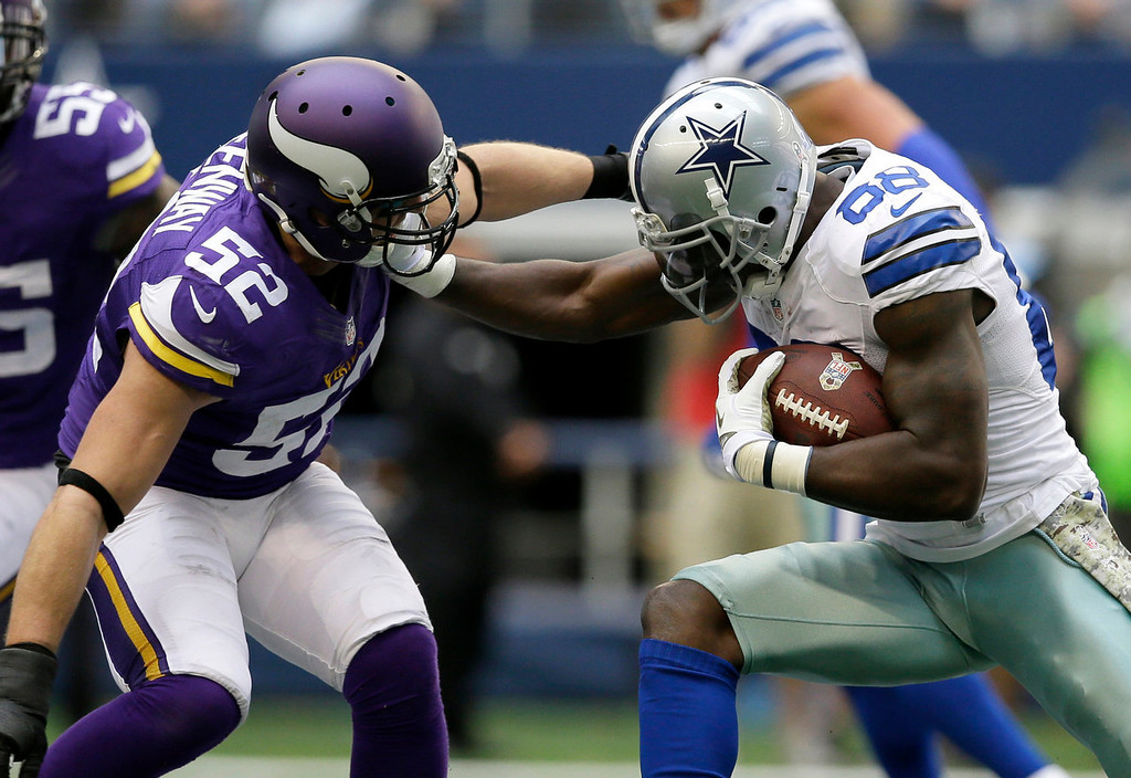 . Minnesota Vikings outside linebacker Chad Greenway (52) tackles Dallas Cowboys\' Dez Bryant (88) after a reception by Bryant in the first  half of an NFL football game, Sunday, Nov. 3, 2013, in Arlington, Texas. (AP Photo/Tim Sharp)
