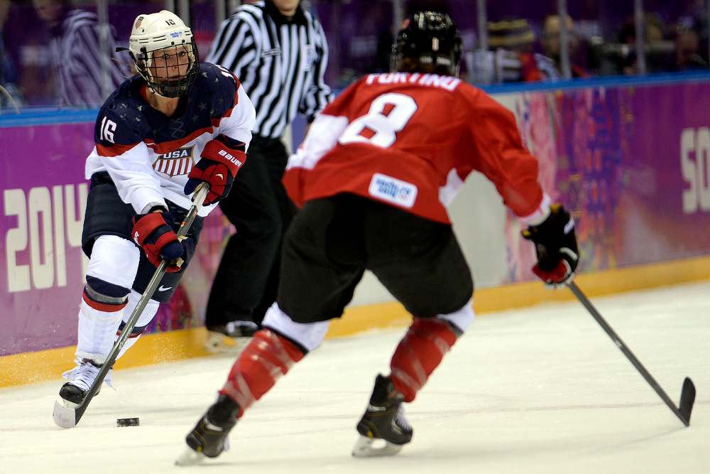 . Kelli Stack (16) of the U.S.A. controls the puck as Laura Fortino (8) of the Canada defends during the first period of the women\'s gold medal ice hockey game. Sochi 2014 Winter Olympics on Thursday, February 20, 2014 at Bolshoy Ice Arena. (Photo by AAron Ontiveroz/ The Denver Post)