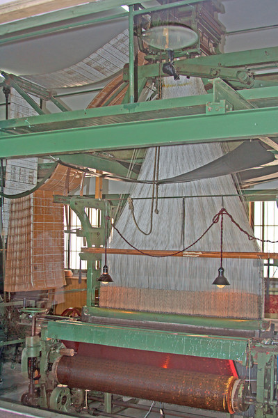 Electric loom weaving silk thread into cloth, China