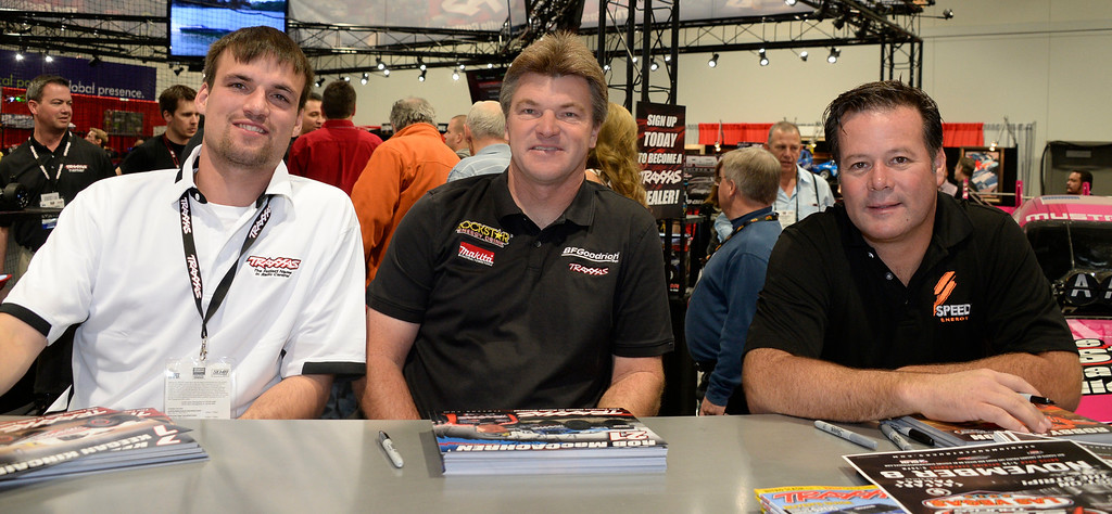 . Nov 6,2013 Las Vegas NV. USA. (L-R) Off road racers Keegan Kincaid, Rob MacCachren and Robby Gordon sign autographs at the Traxxas booth, during the second day of the 2013 SEMA auto show. Photo by Gene Blevins/LA Daily News