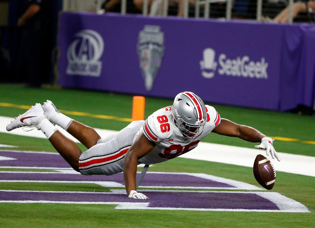 . Ohio State defensive tackle Dre\'Mont Jones (86) jumps on a TCU fumble that was recovered by Ohio State for a touchdown during the first half of an NCAA college football game in Arlington, Texas, Saturday, Sept. 15, 2018. (AP Photo/Michael Ainsworth)