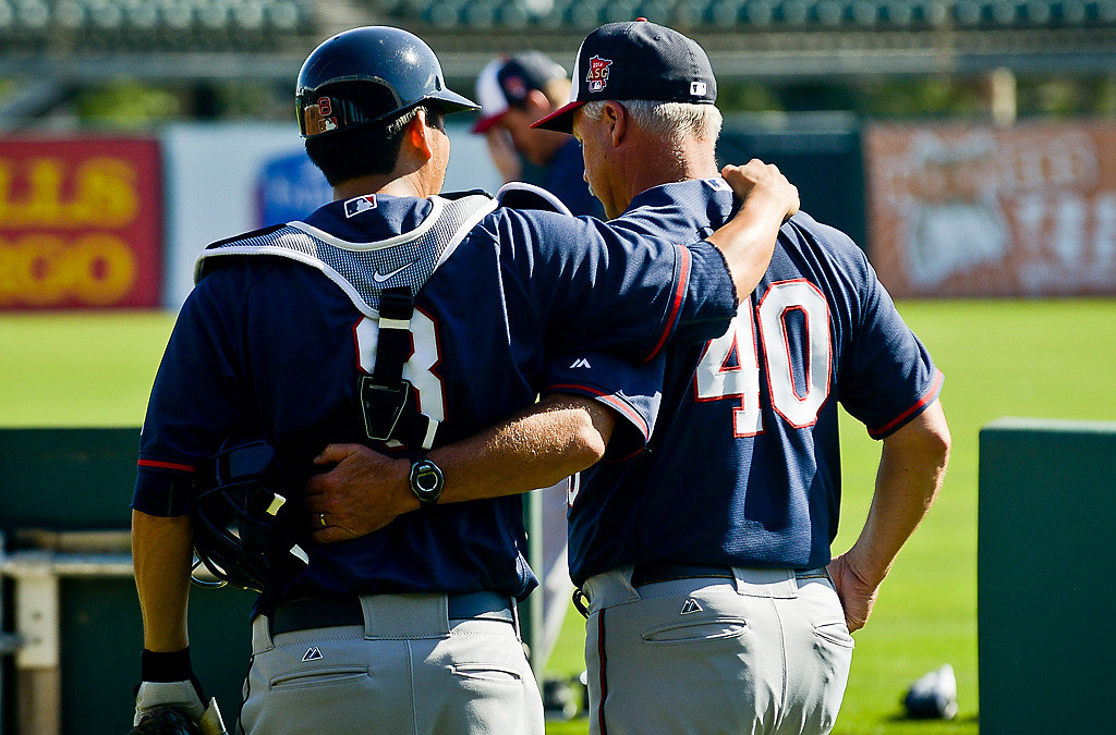 . New Twins catcher Kurt Sukuki, left, is in agreement with pitching coach Rick Anderson following a drill at Hammond Stadium. (Pioneer Press: Ben Garvin)