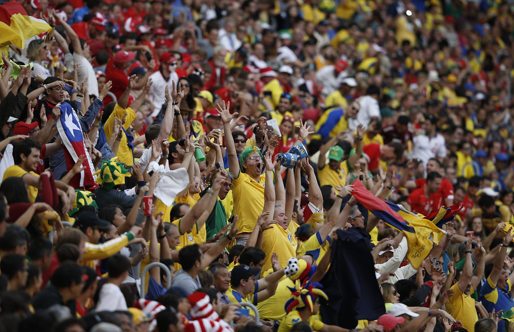. Ecuador\'s fans cheer during a Group E football match between Switzerland and Ecuador at the Mane Garrincha National Stadium in Brasilia during the 2014 FIFA World Cup on June 15, 2014. AFP PHOTO / ADRIAN DENNIS