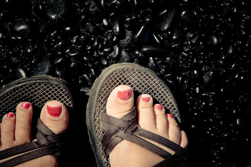 road to hana black sand beach me feet.jpg
