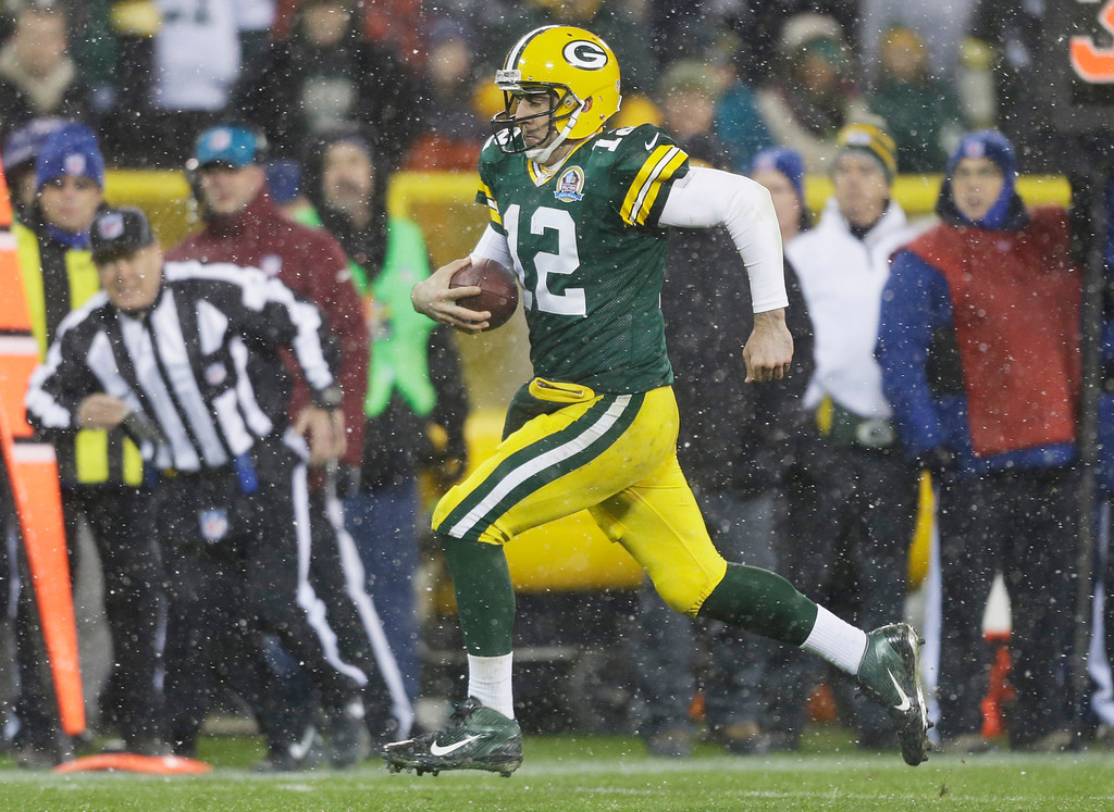 . Green Bay Packers quarterback Aaron Rodgers breaks away for a 27-yard touchdown run during the second half of an NFL football game against the Detroit Lions Sunday, Dec. 9, 2012, in Green Bay, Wis. (AP Photo/Jeffrey Phelps)