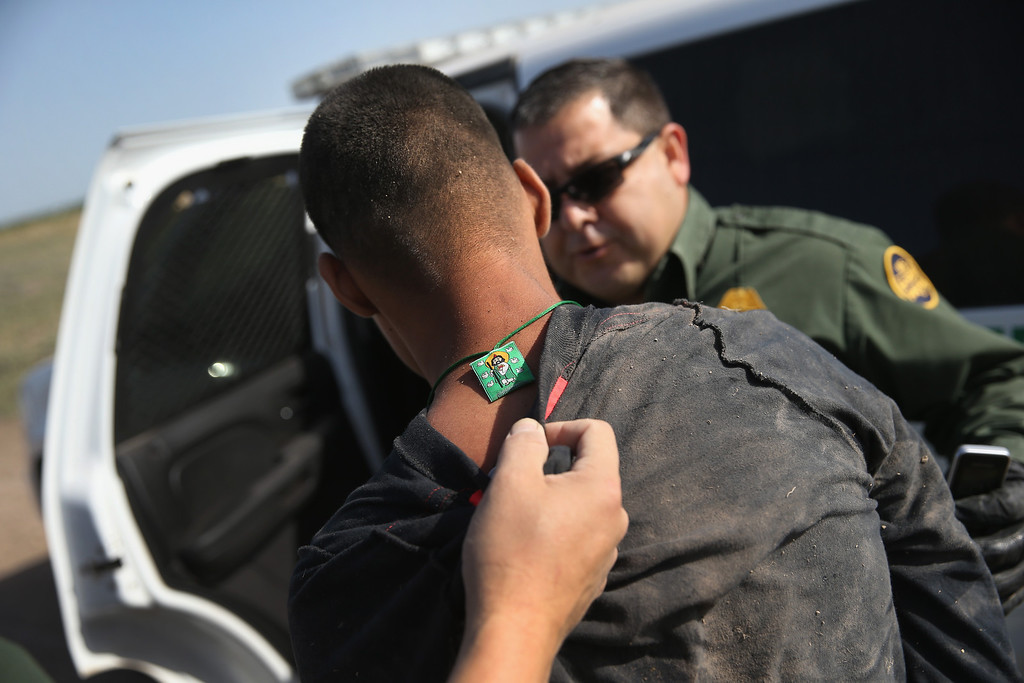 . MISSION, TX - APRIL 11:  U.S. Border Patrol and U.S. Air and Marine agents detain an undocumented immigrant after chasing him down near the U.S.-Mexico border on April 11, 2013 near Mission, Texas. A group of 16 immigrants from Mexico and El Salvador said they crossed the Rio Grande River from Mexico into Texas during the morning hours before they were caught. The Rio Grande Valley sector of has seen more than a 50 percent increase in illegal immigrant crossings from last year, according to the Border Patrol. Agents say they have also seen an additional surge in immigrant traffic since immigration reform negotiations began this year in Washington D.C. Proposed refoms could provide a path to citizenship for many of the estimated 11 million undocumented workers living in the United States. Photo by John Moore/Getty Images)
