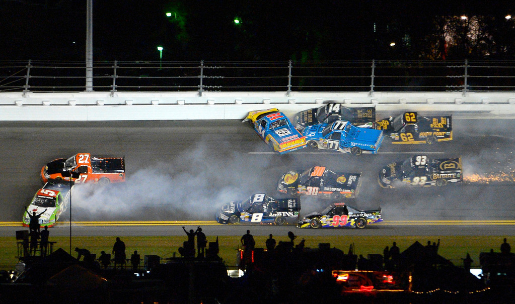 . A wreck between Turns 3 and 4 ensnares Tim George Jr. (5), Jeff Agnew (27), Chris Fontaine (84), Brennan Newberry (14), German Quiroga (77), Brendan Gaughan (62), Jason White (93), Ryan Truex (30), Bryan Silas (99) and Max Gresham (8) during the NASCAR Truck Series auto race at Daytona International Speedway in Daytona Beach, Fla., Friday, Feb. 22, 2013. (AP Photo/Phelan M. Ebenhack)