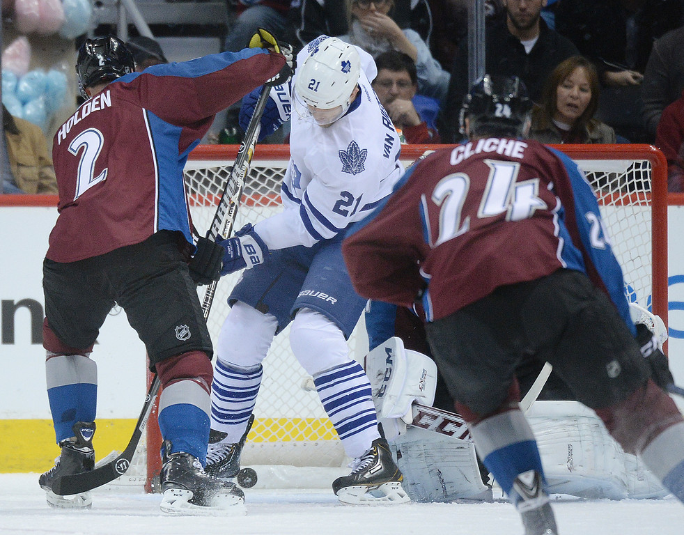 . DENVER, CO. - JANUARY 21:  Toronto wing James van Riemsdyk (21) deflected a shot into the net in the first period for a goal behind Avs defenseman Nick Holden (2) . The Colorado Avalanche hosted the Toronto Maple Leafs Tuesday night, January 21, 2014 at the Pepsi Center. Photo By Karl Gehring/The Denver Post