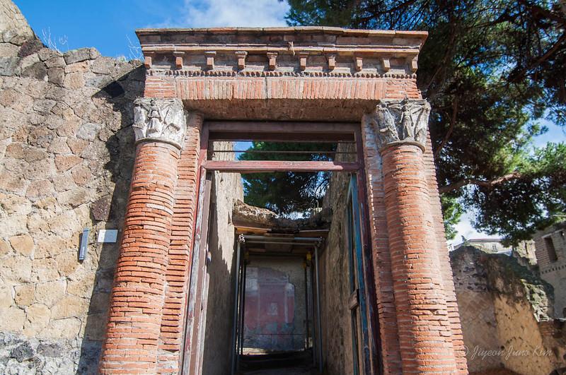 Fully protected columns and door at Herculaneum
