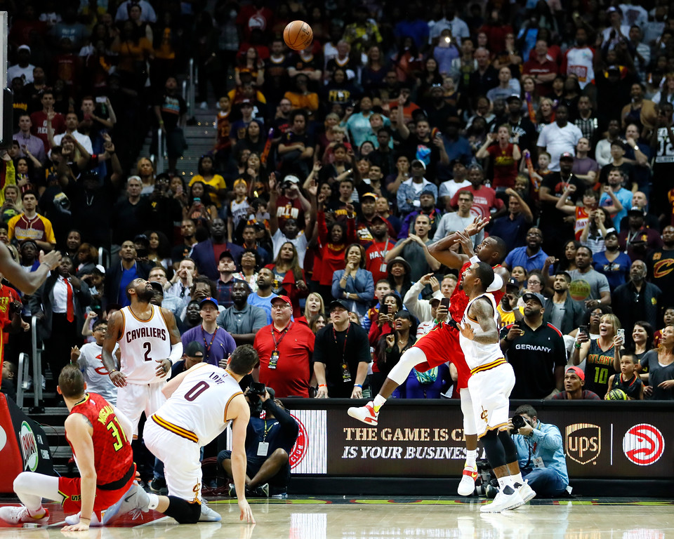 . Atlanta Hawks forward Paul Millsap (4) sinks a 2-pointer to force the game into overtime in the second half of an NBA basketball game against the Cleveland Cavaliers, Sunday, April 9, 2017, in Atlanta. The Hawks won in overtime 126-125. (AP Photo/Todd Kirkland)