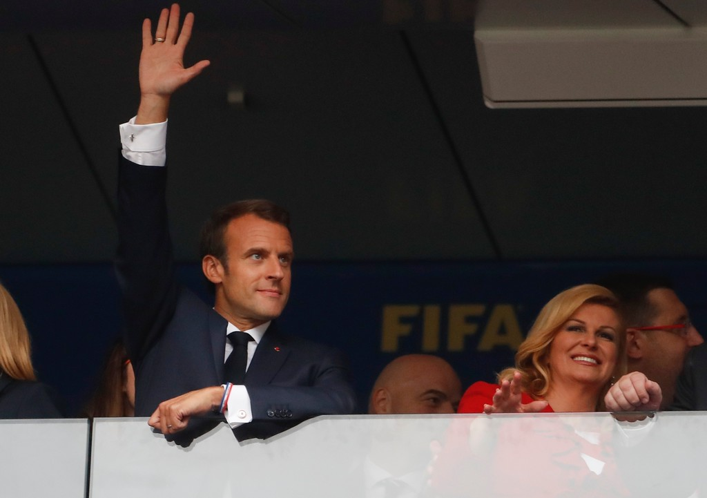 . French President Emannuel Macron, left, and Croatian President Kolinda Grabar-Kitarovic in the stands prior to the final match between France and Croatia at the 2018 soccer World Cup in the Luzhniki Stadium in Moscow, Russia, Sunday, July 15, 2018. (AP Photo/Petr David Josek)