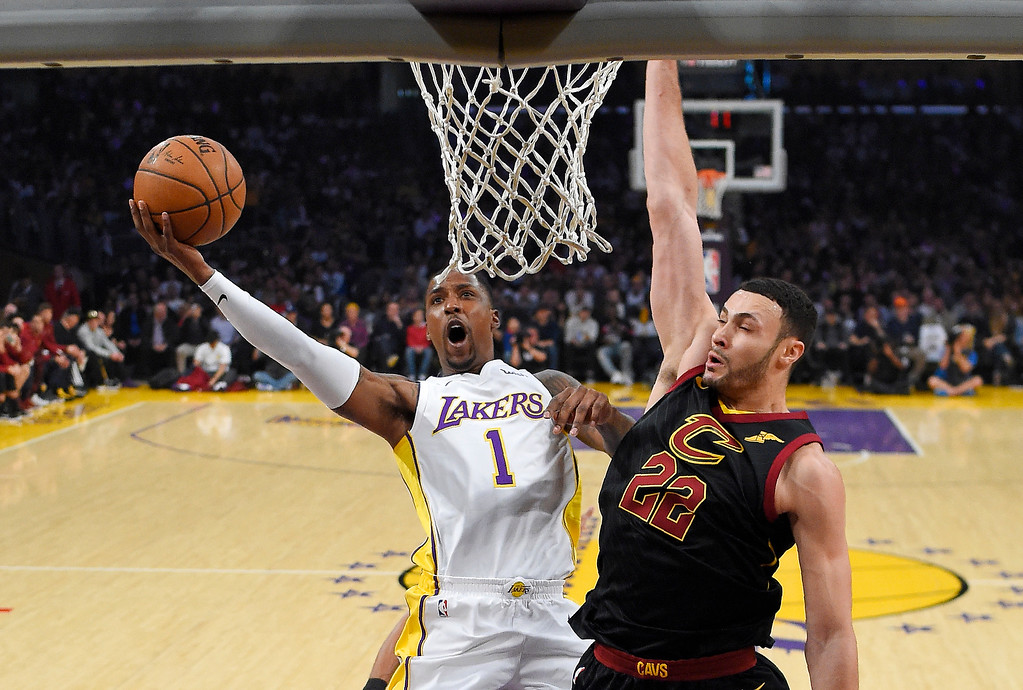 . Los Angeles Lakers guard Kentavious Caldwell-Pope, left, shoots as Cleveland Cavaliers forward Larry Nance Jr. defends during the first half of an NBA basketball game, Sunday, March 11, 2018, in Los Angeles. (AP Photo/Mark J. Terrill)