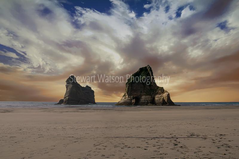 Rock formations off Wharariki Beach at sunset