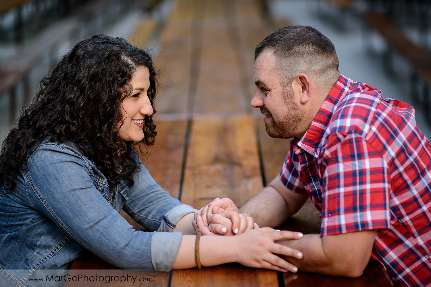 engaged couple holding hands at Saratoga Springs