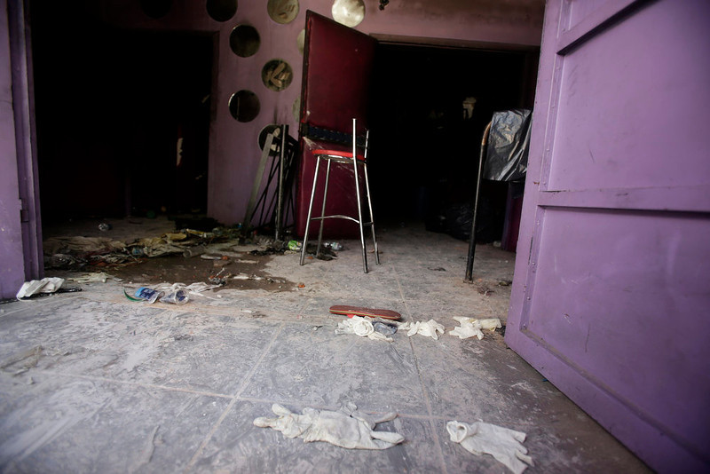 . The damaged entrance of the Boate Kiss nightclub is pictured in the southern city of Santa Maria, 187 miles (301 km) west of the state capital Porto Alegre, January 28, 2013. The Boate Kiss nightclub fire killed at least 233 people in Santa Maria early on Sunday when a band\'s pyrotechnics show set the building ablaze and fleeing partygoers stampeded toward blocked and overcrowded exits in the ensuing panic, officials said. REUTERS/Ricardo Moraes