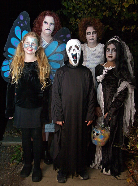 Left to right: Abby, Jenn, Josh, Lisa, Brianna.   I wore an all black caped grim reaper suit (not shown).