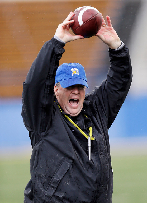 . In this photo taken Wednesday Nov. 28, 2012, San Jose State head coach Mike MacIntyre instructs his team during NCAA college football practice in San Jose, Calif. (AP Photo/Marcio Jose Sanchez)