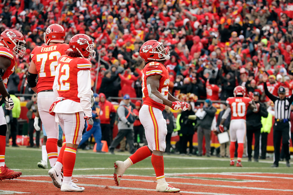 . Kansas City Chiefs running back Kareem Hunt, right, celebrates his one-yard touchdown during the first half of an NFL wild-card playoff football game against the Tennessee Titans, in Kansas City, Mo., Saturday, Jan. 6, 2018. (AP Photo/Charlie Riedel)