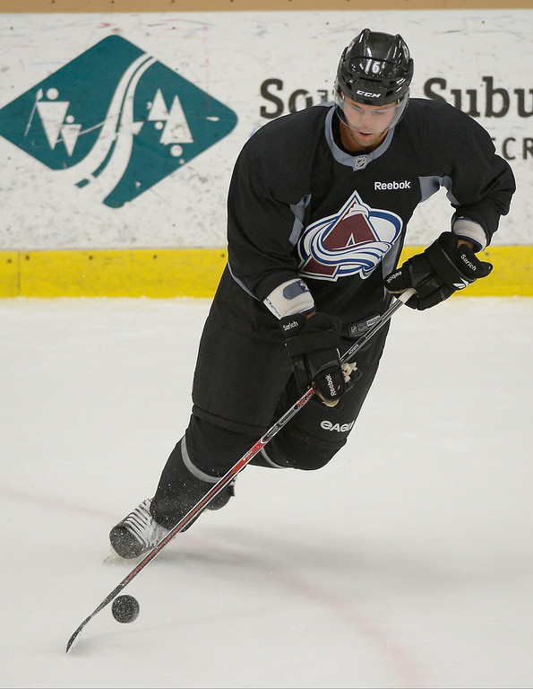 . Colorado Avalanche D Cory Sarich (16) skates with the puck during practice September 9, 2013 at Family Sports Ice Arena. (Photo By John Leyba/The Denver Post)
