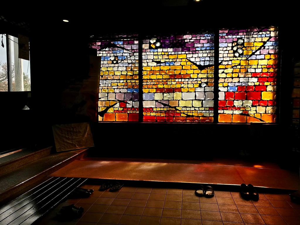 A wall of stained glass.