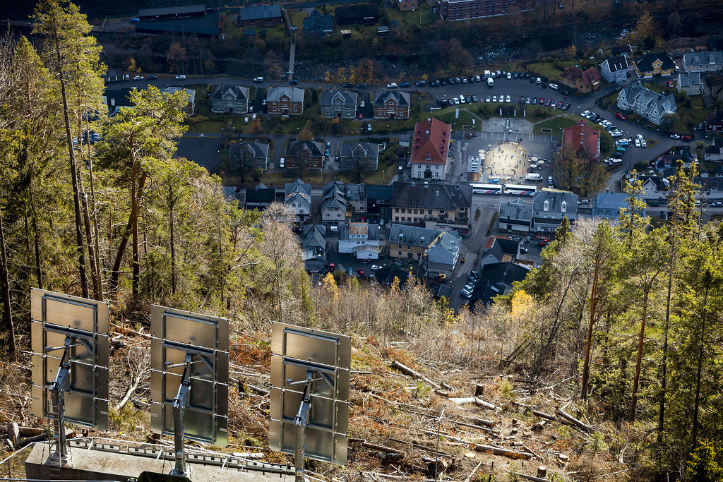""". The huge sun mirrors (\""""Solspeilet\"""") that is set up on the hillside above Rjukan, to reflect sunlight down on the town square, is seen during its officially opening, on October 30, 2013 in Rjukan, 100 years after the idea was first released. Sun-starved residents of a remote Norwegian village unveiled an ingenious mirror system Wednesday to bring natural light to their mountain valley home, enveloped in darkness for half of the year. AFP PHOTO / KRISTER SOERBOE/AFP/Getty Images"""