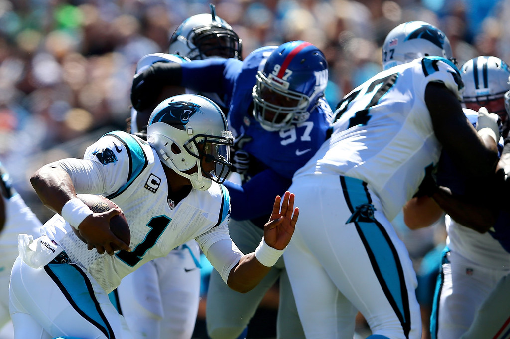 . Cam Newton #1 of the Carolina Panthers runs with the ball against the New York Giants during their game at Bank of America Stadium on September 22, 2013 in Charlotte, North Carolina.  (Photo by Streeter Lecka/Getty Images)