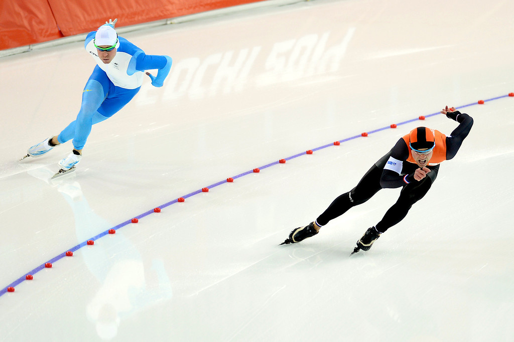 . Silver medalist Jan Smeekens takes the lead around the first turn on Finland\'s Mika Poutala during the speed skating men\'s 500-meter at Adler Arena. Sochi 2014 Winter Olympics on Monday, February 10, 2014. (Photo by AAron Ontiveroz/The Denver Post)