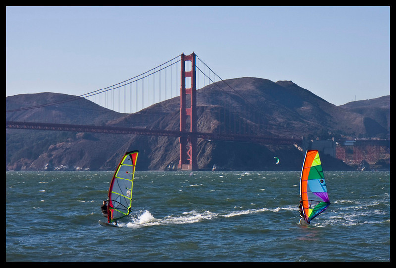 Windsurfers greet us.