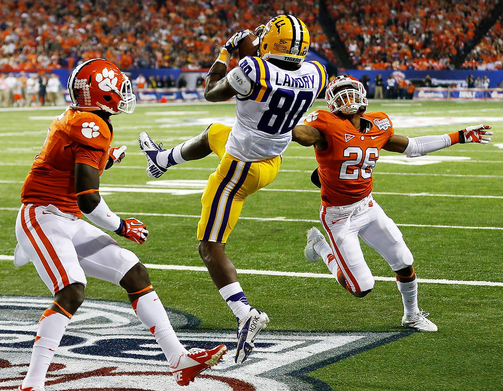 . Clemson safety Jonathan Meeks, left, and defensive back Garry Peters (26) defend as LSU wide receiver Jarvis Landry (80) makes a touchdown catch during the first half of the Chick-fil-A Bowl NCAA college football game, Monday, Dec. 31, 2012, in Atlanta. (AP Photo/John Bazemore)