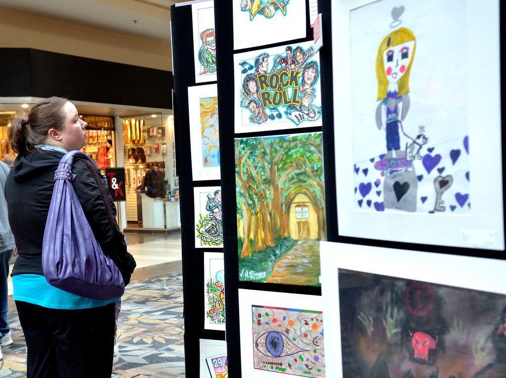 """. Jeff Forman/JForman@News-Herald.com Jacqueline Bryner, of Willoughby, visits the \""""Expressions of Recovery\"""" exhibit at the Great Lakes Mall. The show is sponsored by the Lake County ADAMHS Board."""